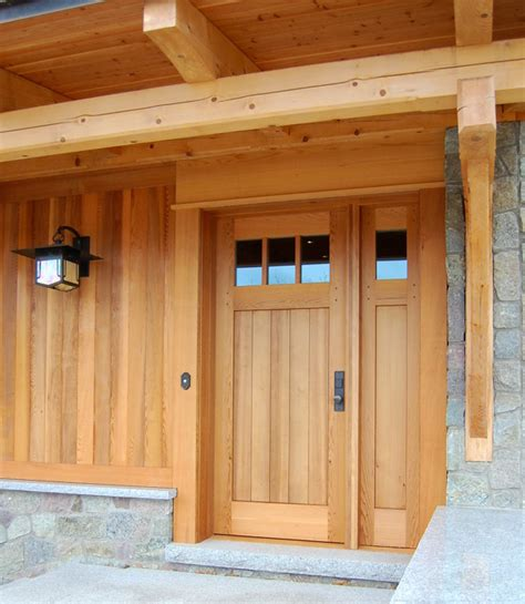 Cedar Front Door by The Design Of A Custom Cedar Door With A Single Sidelight Mimics The Exterior Cedar Paneling On