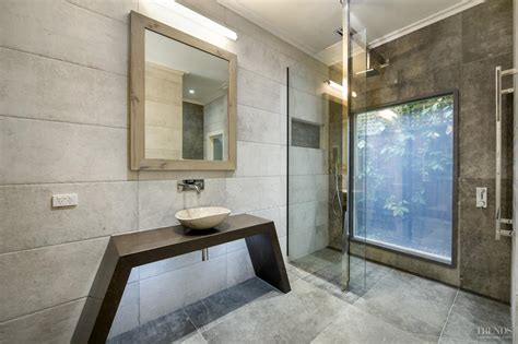 big tiles modern bathroom with switch glass minimalist vanity and large tiles