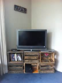 Pick up some wooden crates to make this easy tv stand with extra