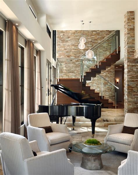 piano in living room stone wall decor and chic chairs using black grand piano