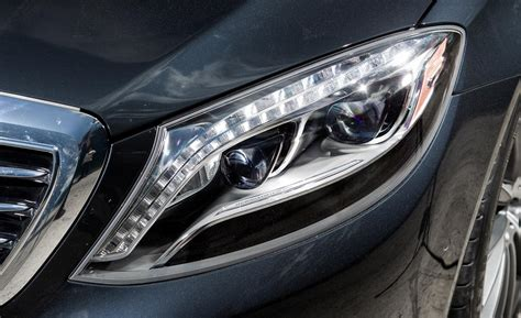 mercedes headlights at car and driver