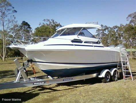 half cabin boats qld new caribbean 2400 power boats boats online for sale