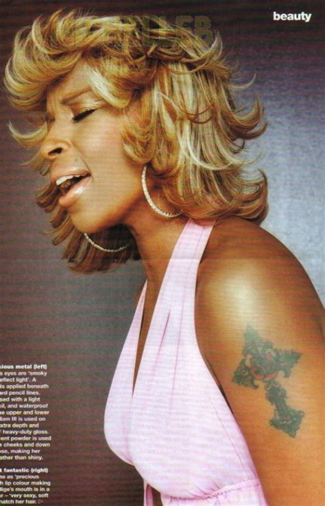 celebrity tattoos mary j blige cross