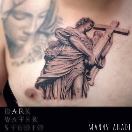 tattoo of angel holding a cross s tattoo designs tattoonow