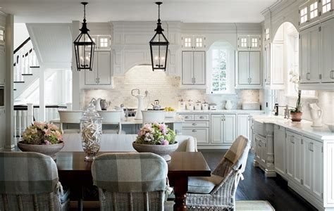 between the boxwoods lanterns kitchen island
