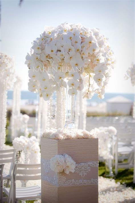 orchids and peonies for a white reception wedding flowers