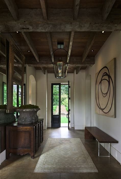 rustic exposed beams ceiling cottage entrance foyer