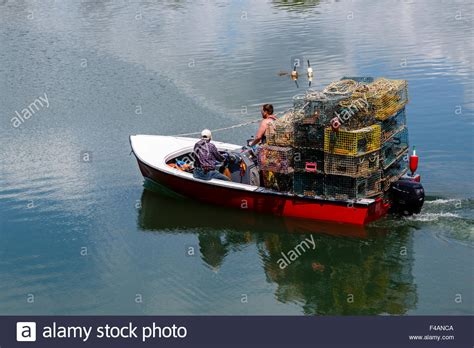 lobster fishing boat images two fishermen on small lobster boat stacked with lobster