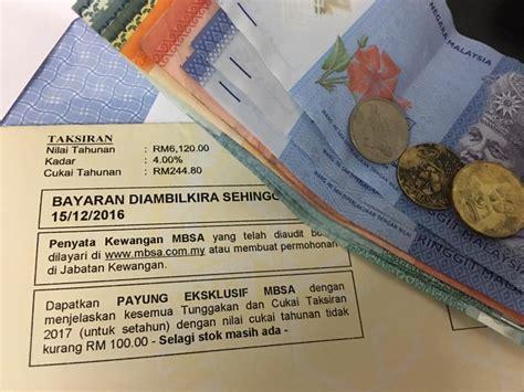 bayar cukai taksiran setahun  payung