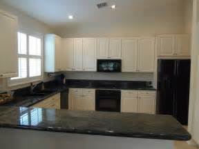 kitchen color ideas with oak cabinets and black appliances ivory kitchens