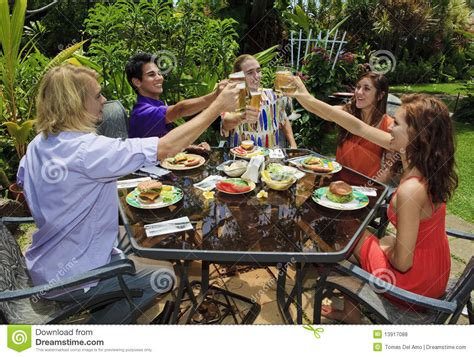 backyard bar b que friends at a backyard bar b que royalty free stock photos