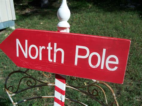 directional sign christmas yard signs north by