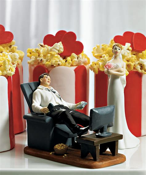 couch potato show couch potato groom figurine shows the bride how the