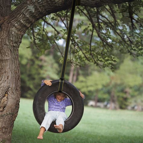 a tire swing hanging from a branch rhino strapmate 1 best selling tree swing strap hanging