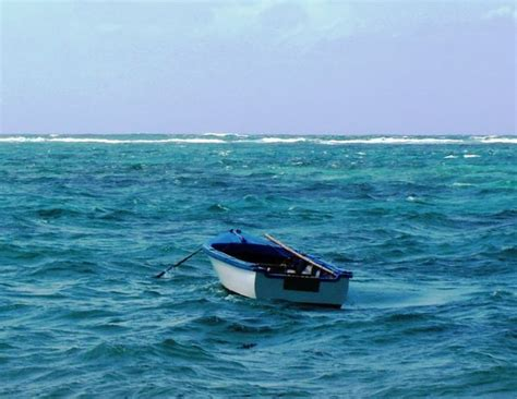 small boat big ocean 3 18 on a small boat out in the middle of the ocean with