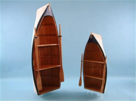 set of two boat shaped bookcases complete with oars these