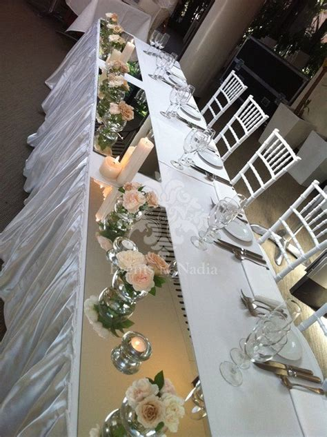 bridal table decorated with long mirrors mini fishbowls