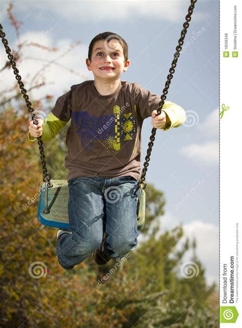 boy swing boy on swing stock photo image of lifestyle joyful