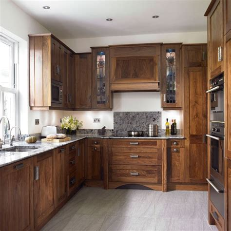 walnut kitchen cabinets take a look around this chic walnut kitchen housetohome