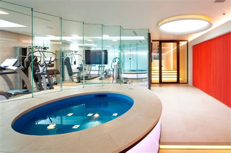 basement pool  london modern home gym