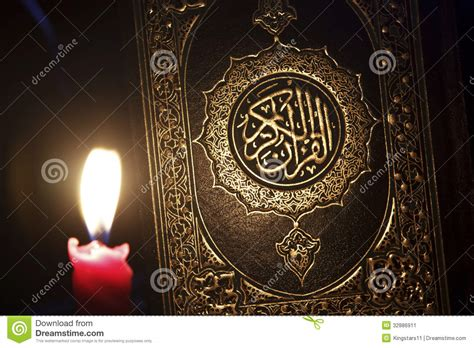 al quran  candle light stock image image