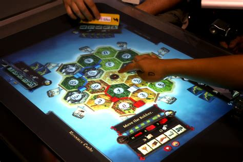 digital board table on with the settlers of catan on microsoft surface