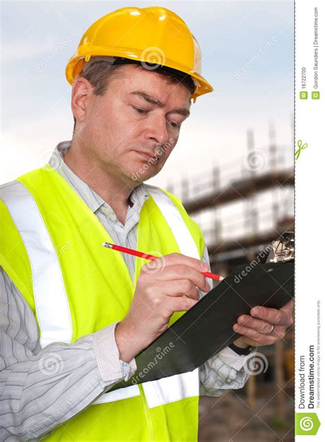 Construction Foreman by Construction Foreman Checks Clipboard Stock Photo Image Of Inspector 16722700