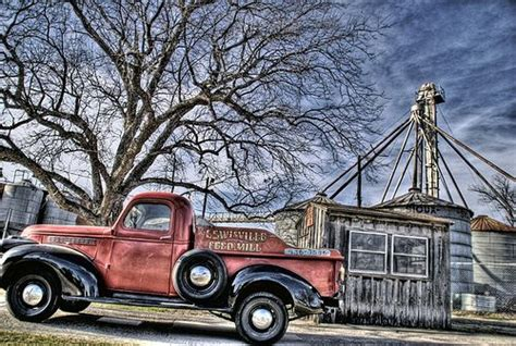 painting of the old lewisville feed mill truck sitting