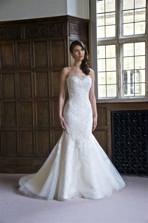 Sleek And Thin Straps Dress sleek and this mermaid style wedding gown features a lovely lace that fades out