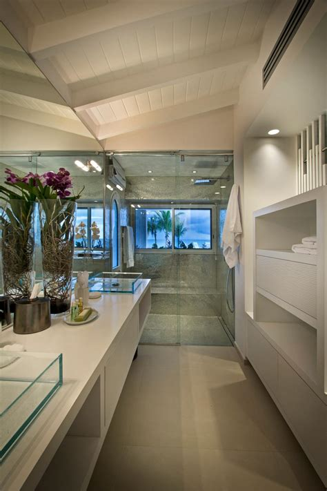 long modern bathroom  double vanity featuring glass