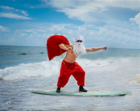 santa on surfboard surfing santa spotting at eau palm resort spa local scoop