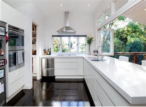 kitchen open bifold windows  white cupboards