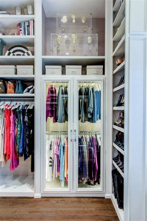 Glass Closet Shelves by Walk In Closet With Slanted Shoe Shelves Transitional