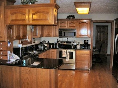 kitchen colors with oak cabinets and black countertops dark oak kitchen cabinets file name kitchen colors