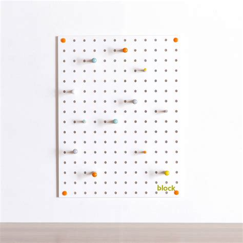 white pegboard with wooden pegs small by block design white pegboard with wooden pegs small by block design