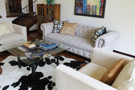cowhide rug living room linen chesterfield sofa glass cocktail table and cowhide