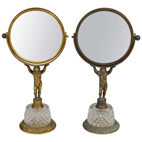 Bronze Vanity Mirror antique pair of bronze and cherub vanity mirrors at 1stdibs