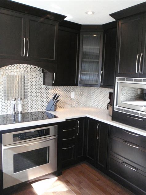 dark kitchen cabinets with white and carrera marble i misty carrera countertops contemporary kitchen