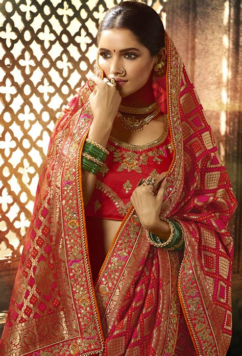 silk red heavy embroidered lace border saree