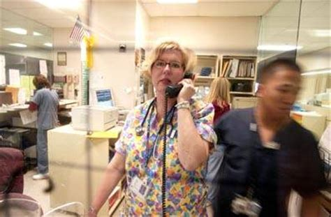 Delaware Background Check Center Rn Pam Brown Checks The Nurses Patient Roster In The Marian Center Emergency