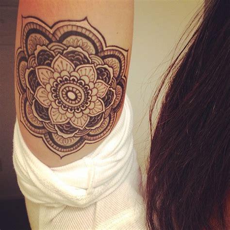henna flower grey ink tattoo on biceps tattooshunt com