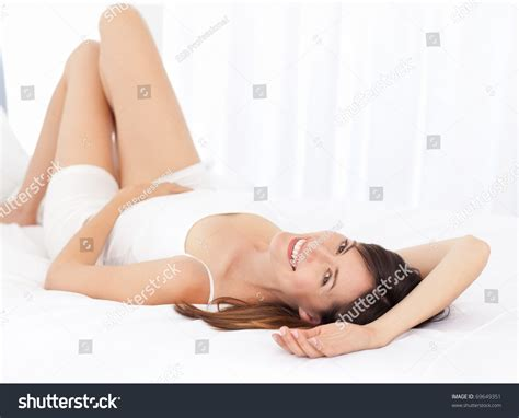 laying down in bed pretty woman lying down on her stock photo 69649351