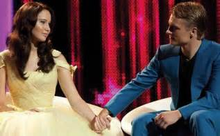 Peeta and katniss at their post games interview