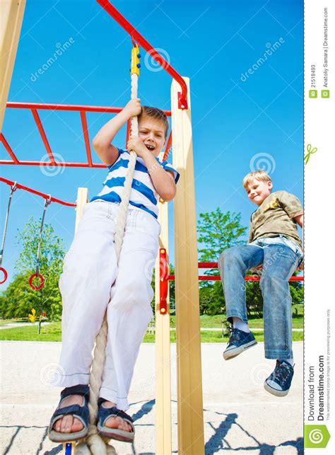 trying swinging scared boy stock photos image 21518493