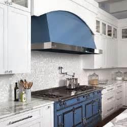 white kitchen with silver iridescent glass backsplash