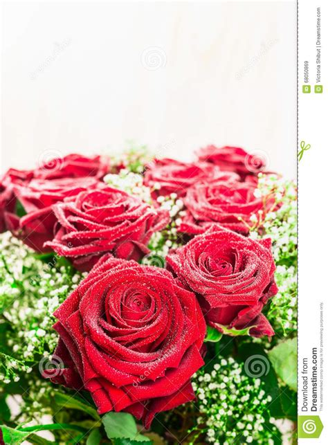 light up red roses red roses bunch on light background close up stock photo
