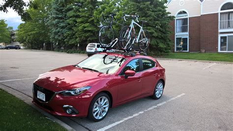 installed oem roof rack cross bars  bike racks mazda