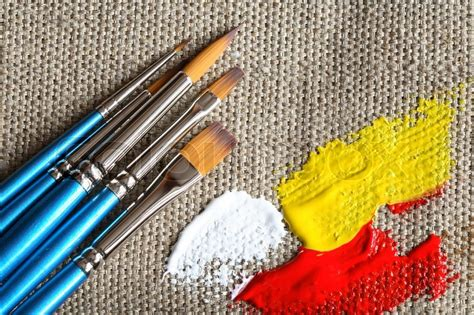 set of paintbrushes and color paint on canvas background stock photo colourbox