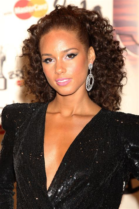 alicia keys updo curly formal hairstyle dark brunette mocha the best hairstyles for long curly hair beautyeditor