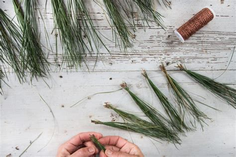 dress up your mantel with a pine needle garland